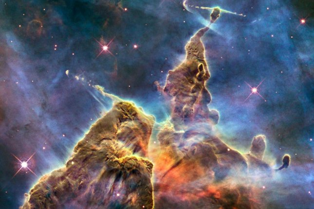 Astronomers mostly think of space dust as fuel for star-forming regions, but new research suggests dust could also carry life from planet to planet. Photo by UPI/NASA