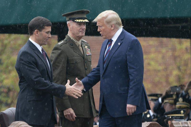 President Donald Trump greets Defense Secretary Mark Esper in Arlington, Va., on September 30. Photo by Chris Kleponis/UPI