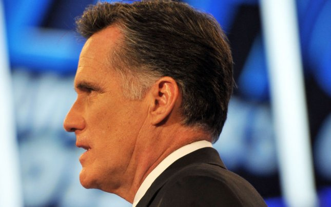 Mitt Romney sings the National Anthem before the Republican Presidential Debate at the Mesa Arts Center in Mesa, Arizona, February 22, 2012. UPI /Art Foxall