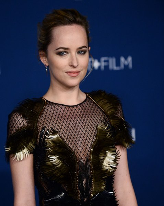 Actress Dakota Johnson arrives at the LACMA Art + Film gala in Los Angeles on November 2, 2013. UPI/Jim Ruymen