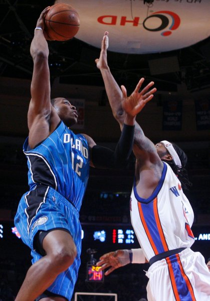 Orlando Magic Dwight Howard (12) shoots a hook shot over New York Knicks Chris Wilcox in the second quarter at Madison Square Garden in New York City on March 23, 2009. (UPI Photo/John Angelillo)