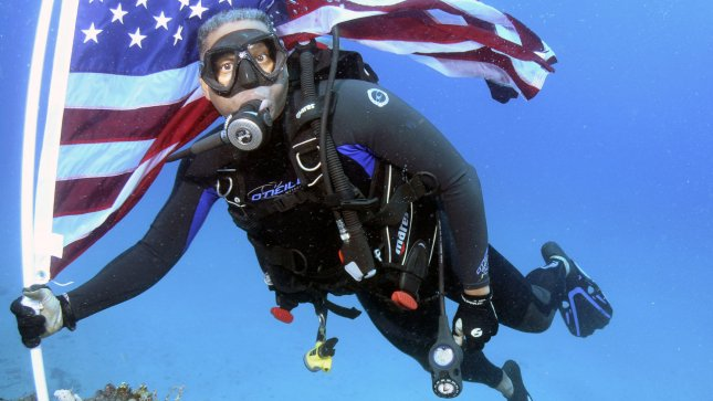 Congressman Allen West (R. Fla), plants the American flag on the wreck of the Ancient Mariner off the coast of Pompano Beach, Fla. on June 12, 2011. Congressman West took part in a SCUBA dive, conducting an Underwater Ceremonial American Flag Tribute. The Congressman, an avid SCUBA diver was also on hand to celebrate Learn to Dive month with US veterans and members of the Diveheart Group. .UPI/Joe Marino