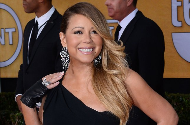 Actress/singer Mariah Carey arrives for the 20th annual SAG Awards held at the Shrine Auditorium in Los Angeles on January 18, 2014. the Screen Actors Guild Awards are telecast live on TNT. (Jim Ruymen/UPI)