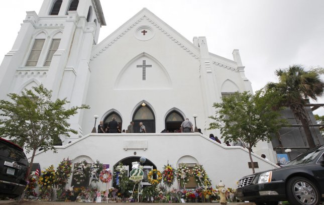 The memorial outside Emanuel A.M.E. Church prior to a viewing of South Carolina State Senator Rev. Clementa Pinckney in Charleston, South Carolina June, 25, 2015. Pinckney and eight other members were murdered at the church last week. Photo by Tami Chappell/UPI
