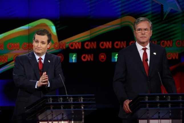 Donald Trump, Sen.Ted Cruz and Jeb Bush, left to right, participate in a debate on December 15, 2015. On Wednesday Bush, who suspended his campaign a mobnth ago, endorsed Cruz. Pool Photo by Ruth Fremson/UPI