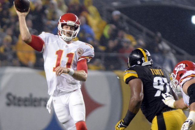 Kansas City Chiefs quarterback Alex Smith (11) steps back to pass as Pittsburgh Steelers defensive end Stephon Tuitt (91) applies pressure in the second quarter against the Kansas City Chiefs at Heinz Field in Pittsburgh on October 2, 2016. Photo by Archie Carpenter/UPI