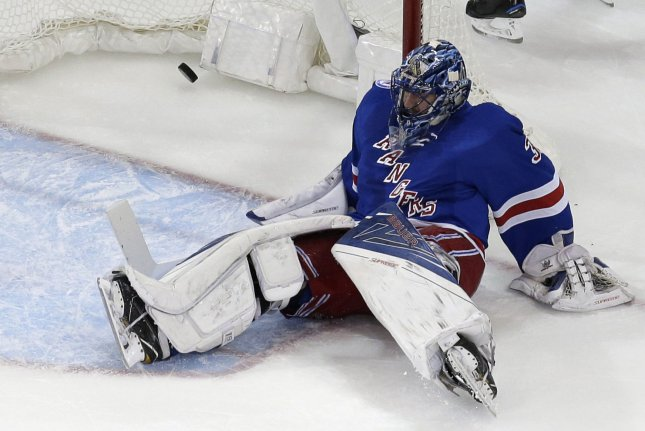 New York Rangers' Henrik Lundqvist lands on the ice after Buffalo Sabres Evander Kane scores a goal in the first period at Madison Square Garden in New York City on January 3, 2017. Photo by John Angelillo/UPI