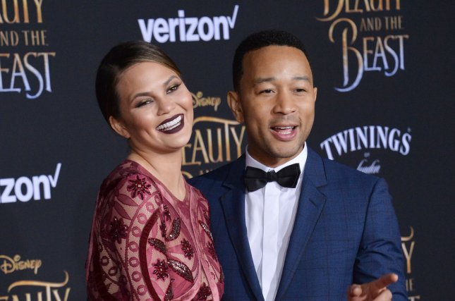 Chrissy Teigen (L) and John Legend attend the Los Angeles premiere of Beauty and the Beast on March 2. The model was named a spokeswoman for Smirnoff this week. File Photo by Jim Ruymen/UPI