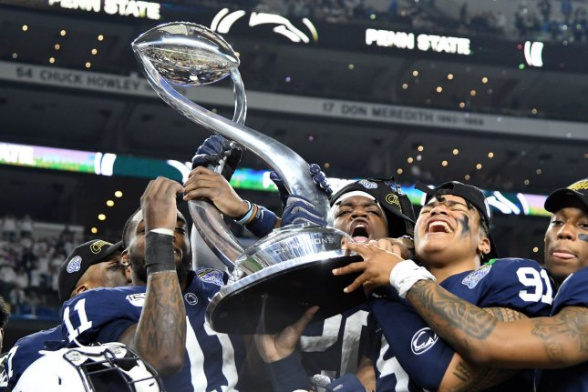 The Penn State Nittany Lions celebrate after defeating the Memphis Tigers in the 84th Goodyear Cotton Bowl Classic on Saturday at AT&T Stadium. Photo by Ian Halperin/UPI