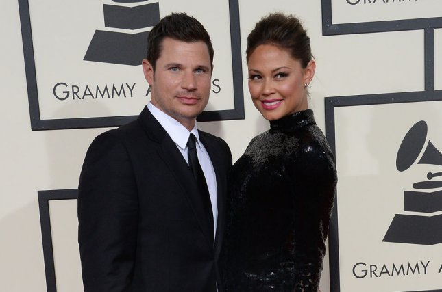 Nick Lachey (L) and Vanessa Lachey voiced their love and gratitude for each other on their wedding anniversary. File Photo by Jim Ruymen/UPI