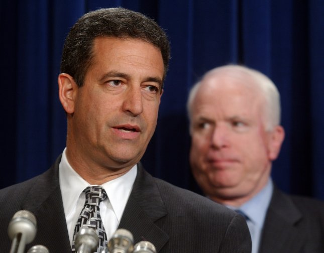 Sen. Russell Feingold speaks to members of the press at a news conference to introduce legislation on campaign 527 reforms, on September 22, 2004 in Washington. Sen. John McCain, R-AZ, looks on...(UPI Photo/Michael Kleinfeld)