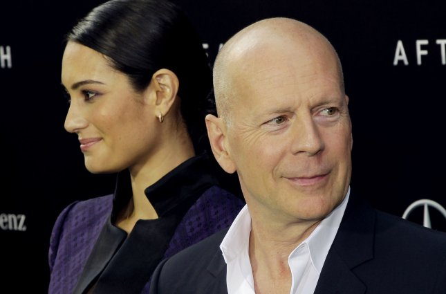 Bruce Willis and Emma Heming-Willis arrive on the red carpet when Columbia Pictures presents the Domestic Premiere of After Earth at the Ziegfeld Theater in New York City on May 29, 2013. After Earth opens nationwide on May 31, 2013 UPI/John Angelillo