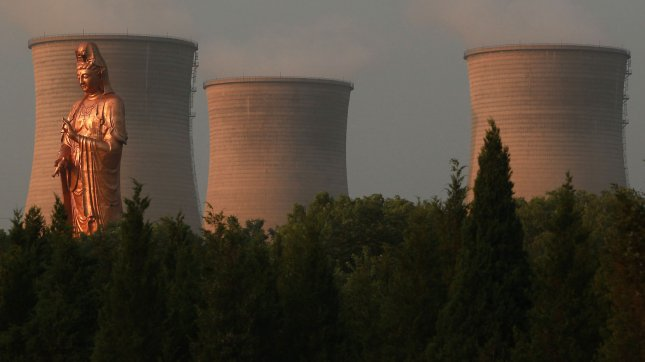 Massive water cooling towers emit vapor at one of Beijing's main coal-fired power plants located next to a park on July 12, 2013. A new study links heavy air pollution from coal burning to shorter lives in northern China. The hazardous quality of the air in northern China will shorten lives by an average of five-and-a-half years, according to a recent study. UPI/Stephen Shaver