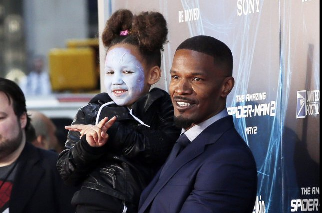 Jamie Foxx and his daughter Annalise arrive on the red carpet at The Amazing Spider-Man 2 premiere at the Ziegfeld Theater in New York City on April 24, 2014. UPI/John Angelillo
