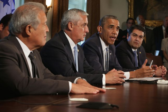 U.S. President Barack Obama (3rd L) speaks as President Otto Perez Molina (2nd L) of Guatemala, President Juan Orlando Hernandez (R) of Honduras, and President Salvador Sanchez Ceren (L) of El Salvador listen during a meeting in the Cabinet Room of the White House in Washington, DC on July 25, 2014. The leaders met to discuss the current situation of migrant children traveling alone to the U.S. UPI/Alex Wong/Pool