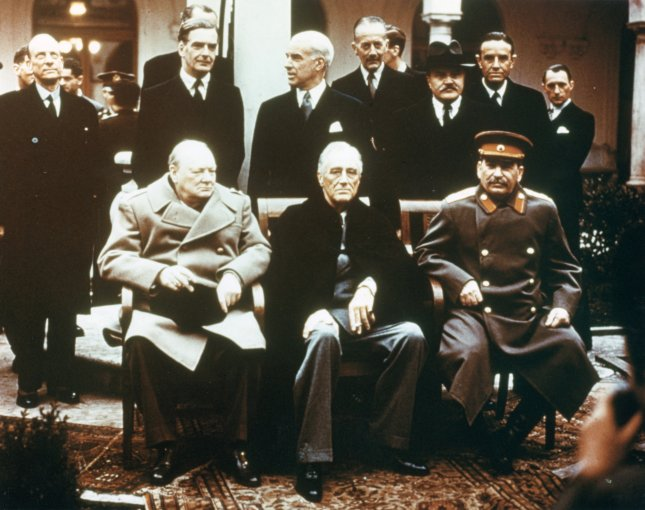 British Prime Minister Winston Churchill (seated, L), U.S. President Franklin D. Roosevelt (C) and Soviet Leader Joseph Stalin are pictured Feb. 9, 1945, at the World War II Yalta Conference on the Crimean Peninsula along with their foreign ministers and other officials. A little over a year later, on March 5, 1946, Churchill gave his famous Iron Curtain speech during a U.S. visit. File Photo/UPI