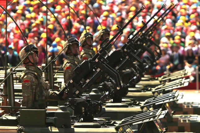 Over 12,000 soldiers and hundreds of tanks, ballistic missile launchers, amphibious assault vehicles, drones, fighter jets, helicopters and other military equipment participate in a massive parade marking the 70th anniversary of victory over Japan and the end of World War II in Beijing on September 3, 2015. Presiding over the extravaganza, President Xi Jinping, China's most powerful leader in decades, said that China would remain committed to the path of peaceful development and unexpectedly vowed to cut 300,000 troops from its 2.3-million strong military - the world's largest. Photo by Stephen Shaver/UPI