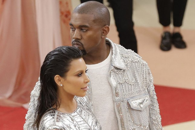 Kanye West (R) and Kim Kardashian at the Costume Institute Benefit at the Metropolitan Museum of Art on May 2. The couple are feuding with Taylor Swift over the rapper's song Famous. File Photo by John Angelillo/UPI
