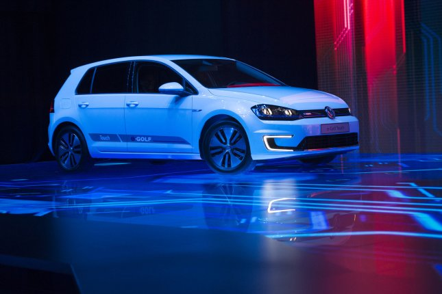 Volkswagen, which debuted the e-Golf Touch, pictured, at the 2016 CES consumer electronics trade show in Las Vegas, agreed on Tuesday to a $1 billion settlement that includes buying back or fixing as many as 83,000 cars originally sold with a device designed to fool emissions tests into thinking the cars were more efficient than they are. In addition to Volkswagen models, the settlement includes several models of the Audi and Porsche brands. File photo by Molly Riley/UPI