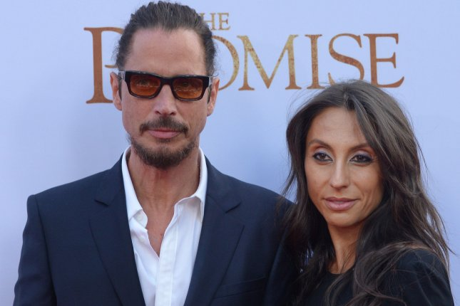 Chris Cornell (L) and Vicky Karayiannis attend the Los Angeles premiere of The Promise on April 12. Karayiannis said in a post Wednesday that she doesn't blame Cornell for his suicide. File Photo by Jim Ruymen/UPI