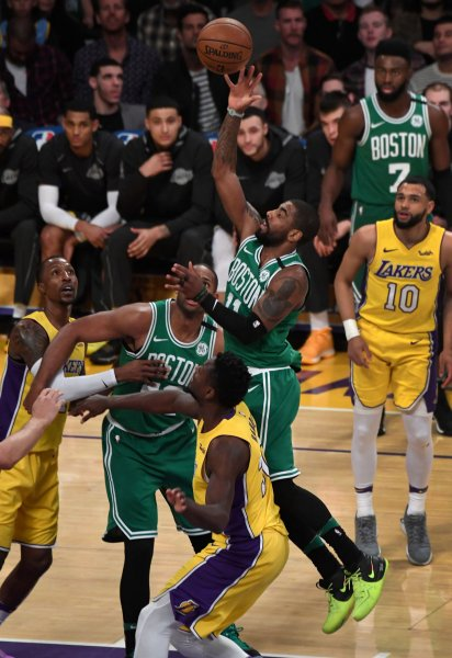 Boston Celtics point guard Kyrie Irving shoots over Los Angeles Lakers forward Julius Randle during their game Jan. 23. Photo by Jon SooHoo/UPI