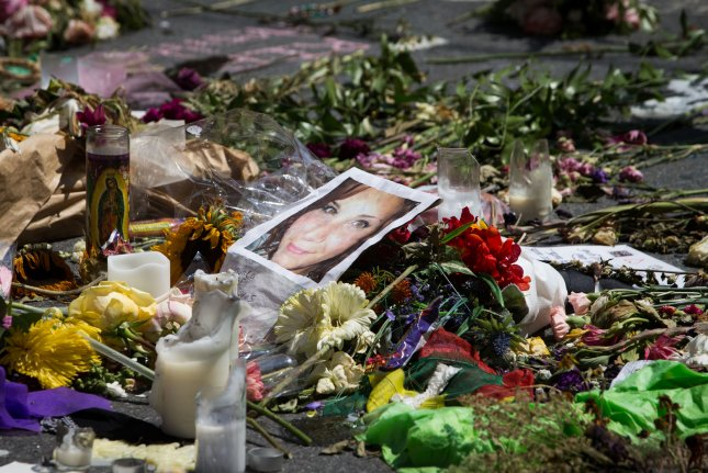 Thousands of flowers and messages cover the street in a makeshift memorial at the site where Heather Heyer was killed in Charlottesville, Va. last year. File Photo by Erin Schaff/UPI