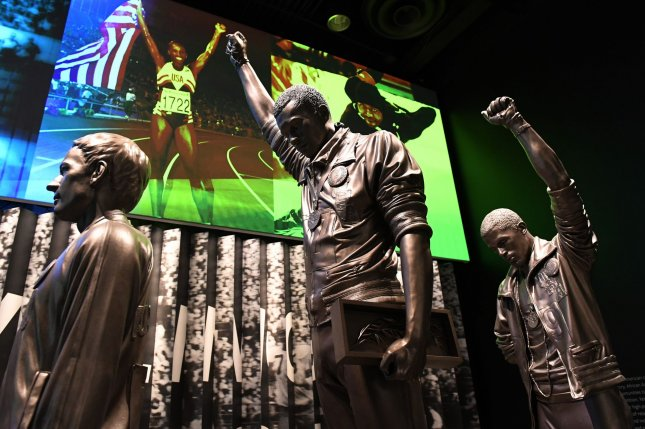 A sculpture depicts the raised-fist protest by U.S. track athletes Tommie Smith and John Carlos at the 1968 Summer Olympics in Mexico City, as part of a sports exhibit at the Smithsonian National Museum of African American History and Culture in Washington, D.C., on September 14, 2016. File Photo by Pat Benic/UPI