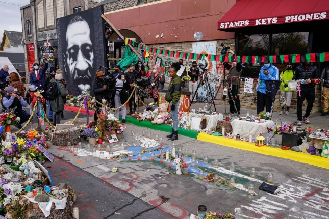 Activist Nylisha stands over the spot where George Floyd died at Chicago Avenue and 38th Street in Minneapolis on Tuesday after former police officer Derek Chauvin was convicted on all counts in Floyd's death. Photo by Jemal Countess/UPI