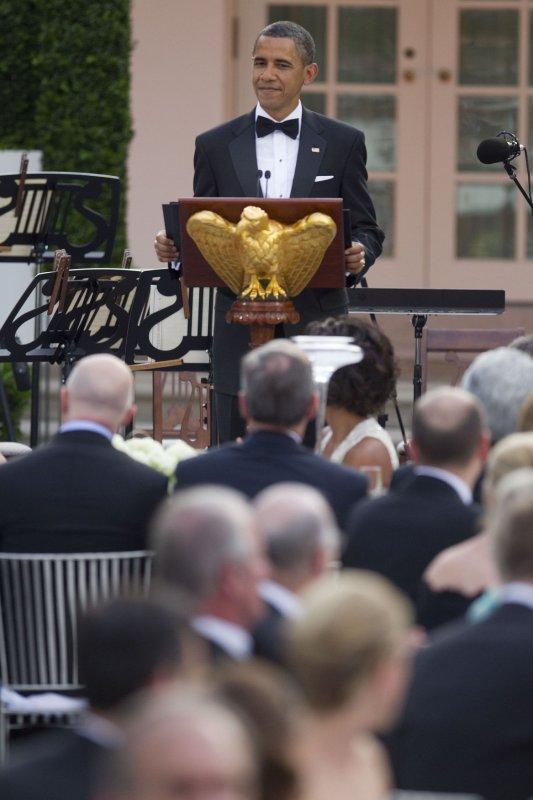 U.S. President Barack Obama speaks during a State Dinner with Angela Merkel, Germany's chancellor, in the Rose Garden of the White House in Washington, D.C., on June 7, 2011. UPI/Andrew Harrer/POOL