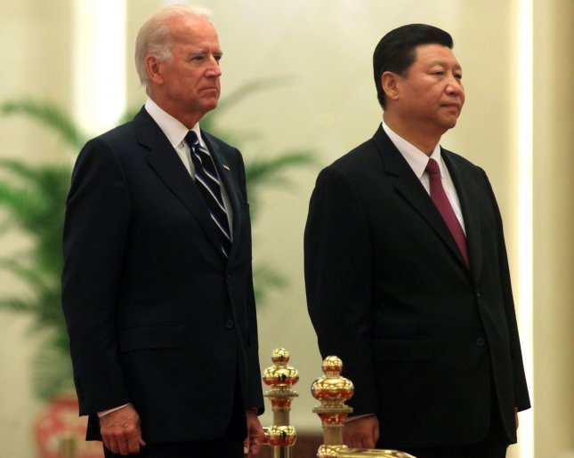 U.S. Vice President Joe Biden (L) and his Chinese counterpart Xi Jinping listen to their respective national anthems during a welcoming ceremony at the Great Hall of the People in Beijing on August 18, 2011. Global economic stability rests on the United States and China working together, Biden told China's president-in-waiting Xi, in talks seeking to shore up confidence in the dollar and bond with Beijing's next leader. UPI/Stephen Shaver