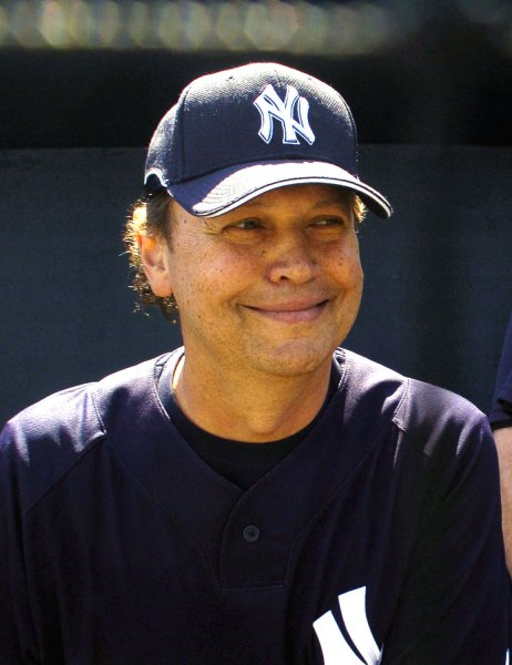 Comedian and New York Yankee Billy Crystal smiles for the cameras before a game against the Pittsburgh Pirates at Legends' Field in Tampa, Florida on March 13, 2008. Crystal signed a one-day contract with the Yankees as part of a birthday wish. Crystal will turn 60 on March 14. The Pirates beat the Yankees 5-3. (UPI Photo/Cathy Kapulka)