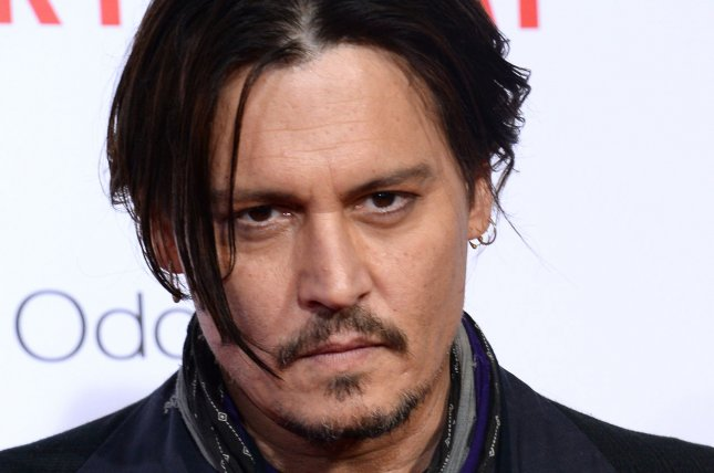 Cast member Johnny Depp attends the premiere of the motion picture comedy Mortdecai at the TCL Chinese Theatre in the Hollywood section of Los Angeles on January 21, 2015. File Photo by Jim Ruymen/UPI