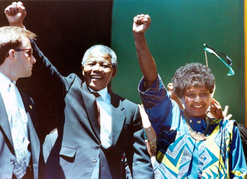 Winnie Mandela, right, seen here in 1990 with ex-husband Nelson Mandela, is accused of meddling in her grandson's rape arrest. File Photo by UPI/Dan Groshong