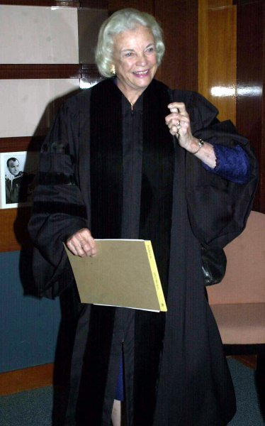 Sandra Day O'Connor's nomination -- by President Ronald Reagan -- to the U.S. Supreme Court was unanimously approved Sept. 21, 1981, by the Senate. O'Connor, the first female member of the high court, is pictured before giving a commencement address at a New York law school June 1, 2004, the year before she announced she would retire from the court. File Photo by Ezio Petersen/UPI