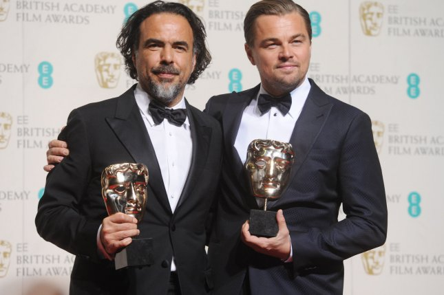 American actor Leonardo DiCaprio and Mexican director Alejandro G. Inarritu hold two of the five awards including Best Director and Best Actor for the Revenant in the winner's room at the EE British Academy Film Awards at the Royal Opera House in London on February 14, 2016. Photo by Rune Hellestad/UPI