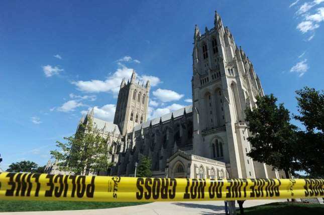 A new study suggests the southeastern United States will be seismically active for some time. Pictured, police tape ropes off the Washington National Cathedral after an earthquake hit the area on August 23, 2011 in Washington, D.C. Three pinnacle spires on the central tower (top left) fell off. A 5.9 magnitude earthquake centered in Virginia forced evacuations in the nation's Capital. File photo by Pat Benic/UPI