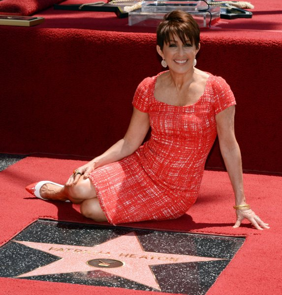 Actress Patricia Heaton sits next to her star during an unveiling ceremony honoring her with the 2,472nd star on the Hollywood Walk of Fame in Los Angeles on May 22, 2012. Her sitcom The Middle has been renewed for a ninth season. File Photo by Jim Ruymen/UPI