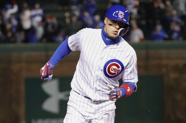Chicago Cubs' Javier Baez runs the bases after hitting a home run. File photo by Kamil Krzaczynski/UPI