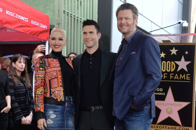 Gwen Stefani, Adam Levine and Blake Shelton (L-R) attend Levine's Hollywood Walk of Fame ceremony on February 10. Stefani posted a photo Friday of Shelton playing with her son Apollo. File Photo by Jim Ruymen/UPI
