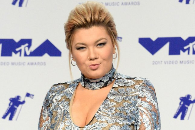 Amber Portwood shared a picture with Gary Shirley and daughter Leah amid rumors she's expecting with Andrew Glennon. File Photo by Jim Ruymen/UPI