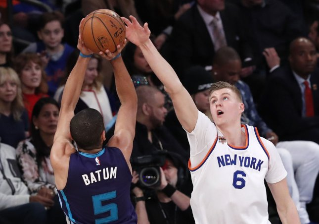 Charlotte Hornets forward Nicolas Batum attempts to shoot over New York Knicks big man Kristaps Porzingis during a recent game. Photo by John Angelillo/UPI