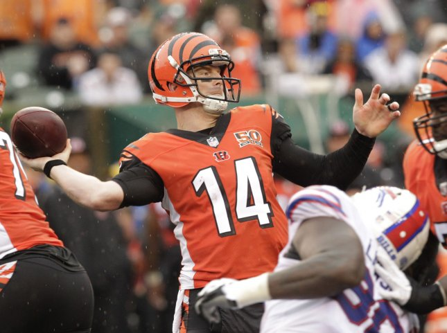 Cincinnati Bengals quarterback Andy Dalton throws under pressure during a game against the Buffalo Bills in October. Photo by John Sommers II /UPI
