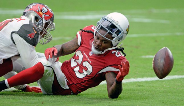 Former Arizona Cardinals running back Chris Johnson loses the ball after scoring a touchdown during the game against the Tampa Bay Buccaneers in 2016. Photo by Art Foxall/UPI