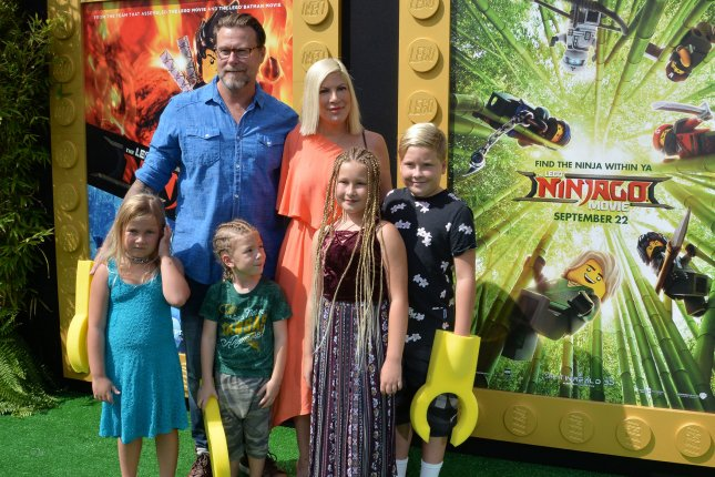 Tori Spelling and Dean McDermott, pictured with their kids, dedicated sweet posts to each other on their 12th wedding anniversary Monday. File Photo by Jim Ruymen/UPI