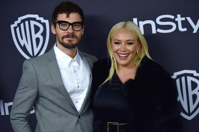 Lizzie McGuire star Hilary Duff (R) with her husband Matthew Koma. Lizzie McGuire creator Terri Minsky has exited the revival series. File Photo by Christine Chew/UPI