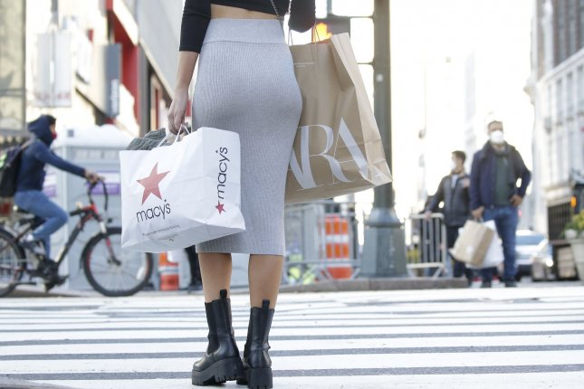 A shopper holds a bag from Macy's in New York City's Herald Square on Black Friday, November 27, 2020. Americans spent billions online over the 2020 holiday shopping season. File Photo by John Angelillo/UPI