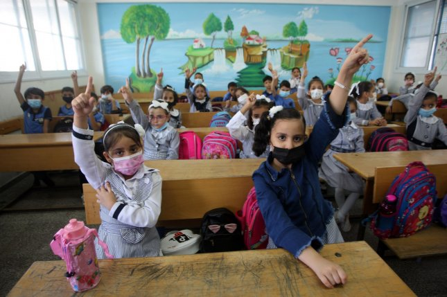 Palestinian refugee children are seen at a United Nations school in Gaza City on August 16. Photo by Ismael Mohamad/UPI