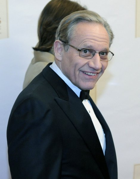 Journalist Bob Woodward arrives on the red carpet at the Ford's Theater official reopening celebration, marking the bicentennial of U.S. President Abraham Lincoln's birthday, in Washington on February 11, 2009. (UPI Photo/Alexis C. Glenn)
