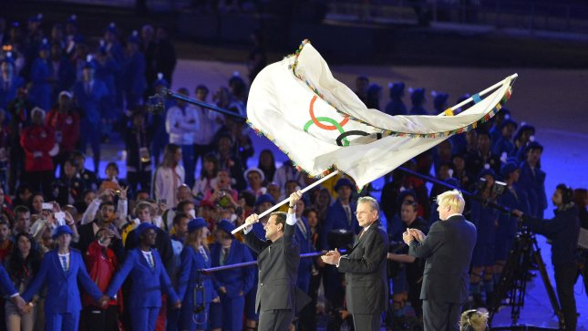 Eduardo Paes, Mayor of Rio de Janeiro, (L) waves the Olympic Flag after it was passed from Boris Johnson, Mayor of London, (R) to Jacques Rogge, President of the International Olympic Committee, who then handed the flag to Paes during the Closing Ceremony for the London 2012 Summer Olympics on August 12, 2012 in Stratford, London. The next Summer Olympic Games will be in 2016 in Rio de Janeiro. UPI/Brian Kersey