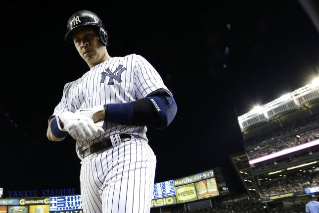 New York Yankees Alex Rodriguez walks to the dug out after grounding out in the 7th inning against the Detroit Tigers at Yankee Stadium in New York City on June 19, 2015. Earlier Alex Rodriguez hit career MLB hit number 3000 with a solo home run in the first inning. Photo by John Angelillo/UPI